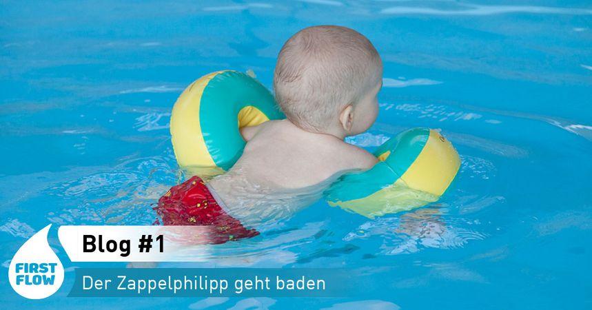 Baby_schwimmt_Schwimmflügel
